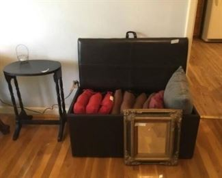 Storage chest, pillows, small table