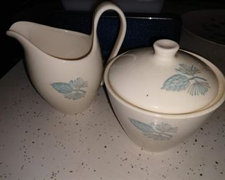 "This is the sugar bowl and creamer set out of the larger set of ""Blue Spruce Pinecone"" Marcrest Stetson vintage dinnerware set. The sugar bowl lid has several cracks, you can't see them in this pic, but the creamer has none."