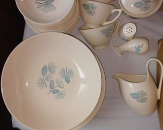 "Marcrest Stetson ""Blue Spruce Pinecone dinnerware set. Plates and bowls are all in good shape. A couple of the cups have had the handles glued back on, and the sugar bowl lid, top right, has cracks, possibly glued."
