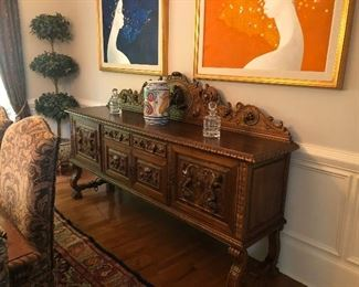 Antique heavily carved buffet with matching table