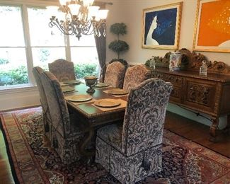 6 upholstered chairs and antique walnut dining table. Also have the original walnut and leather chairs. Beautiful carving.