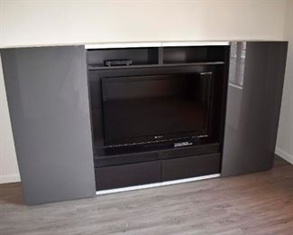 Television not included (this bid is for the entertainment center only)