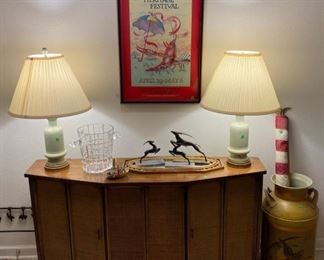 Rattan credenza, jadeite-colored ceramic lamps, deco pieces, painted milk jug, vintage flag, JAZZFEST poster