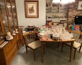 BEAUTIFUL MCM dining set and six chairs. Plus, every glass serving piece you'll need to set up your daughter's home