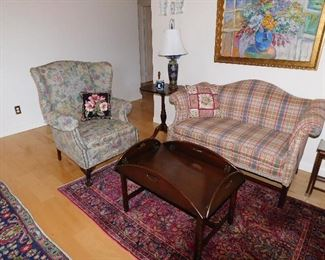 "Chippendale style love seat plaid silk, 33""d x 57""wx31""h w/needle point pillow $450.00, Wing back chair w/carved paw feet & needle point pillow, 33"" x 33""x41""h $275.00, Mahogany butlers coffee table 30"" x 40"" $150.00, Mahogany candle stand 21"" x 19""x28""h $90.00, Lamp made from cobalt antique Japanese vase $75.00, Wedgwood style ""adams"" vase cobalt $30.00"