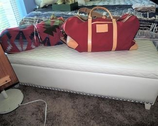 Leather blanket chest * Woven blanket * Coach overnight bag