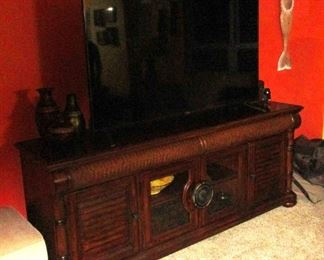 Entertainment Console by Cindy Crawford with giant 65 inch smart TV ..year old
