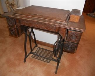 Antique Wheeler & Wilson sewing machine and cabinet.