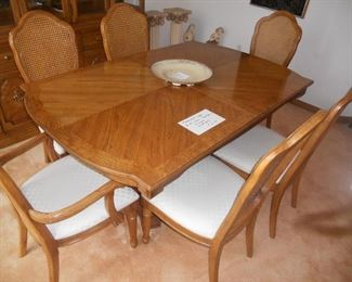 Thomasville dining room set .  2 leaves and custom pads.