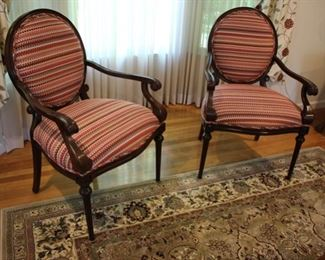 "For a pop of color we are offering this pair of wooden open armchairs with curved arms; striped upholstery on seat back and back of chair. Measures: 40""h x 28""w x 21 1/2""d Asking: $400 pr"