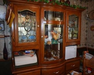 Beautiful Breakfront Dining Room Cabinet featuring lighted display cabinet and storage for silver, linens, etc. plus matching round oak table and chairs still to be pictured