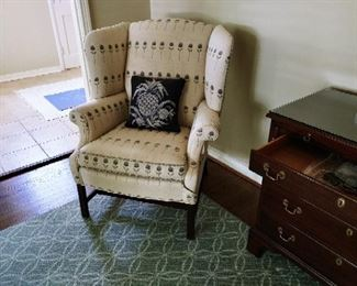 pair of upholstered wingback chairs $400