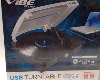 https://connect.invaluable.com/randr/auction-lot/new-sealed-vibe-usb-turntable-w-built-in-speakers_0AF46D58E0