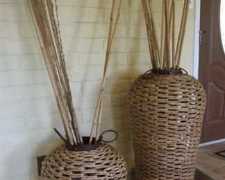 """#2.  $$100.00.  Pair wicker decorative vessels with rods  larger 46"""" height 19"""" diameter the smaller is 30"""" height 19"""" diameter"""