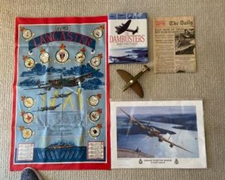 Owner's collection of memorabilia from his RAF days - and the Dam Busters raid in which he participated.  Original newspaper article, historical book, poster, hand constructed bronze Lancaster airplane, etc.
