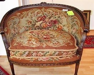 Beautiful needlepoint covered settee with carved accents