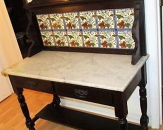 Unusual marble top, tile back stand from Portugal. Has 2 storage drawers. Back splash is removable. Hand painted tiles.