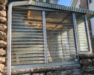 Enclosed porch parts. Negotiable on price if you take it down. Hard to find these days. We want an exposed porch.