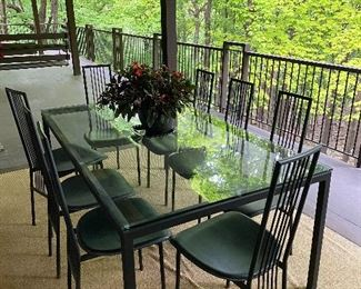 """$400 (1/2 photos) Custom iron/glass Indoor/ outdoor dining set with 8 chairs. Gorgeous Parson's Table. 71.5"""" long x 42"""" wide 28.5"""" tall. Excellent condition. Chairs are black iron with faux leather seat. 18"""" seat, 40"""" to top of chair."""