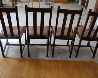 Antique chairs, set of four.  Seat cushions removable.  Dark oak.  Solid.   $80.  Will consider reasonable offers.