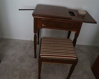 Vintage sewing machine in cabinet with bench.  Singer 201-2, 1938.  $190.  Will consider reasonable offers.