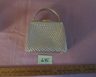 615  Bally gold bag $175