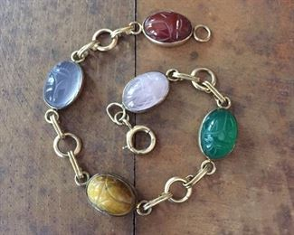 """Vintage 12K gold filled bracelet with carved scarab cabochons of carnelian, chalcedony, tiger's eye, green onyx and rose quartz.   7 1/2"""" L, marked 1-20 12 G.F. on clasp.   $110"""