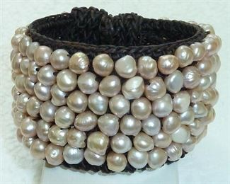 Genuine freshwater pearls in pale pastels of peach, pink, cocoa and creme sewn on an extra wide woven chocolate macrame cuff bracelet.  Yummy!  $120