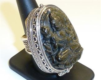 """HUGE poison ring.  This awesome ring is 2"""" tall and 1 1/4"""" wide, and you could hide all sorts of goodies in it :-) Sterling silver, and carved chalcedony.  It appears dark chocolate, but has fine sparkles of gold all throughout when in the light.  Simply stunning.  $600"""