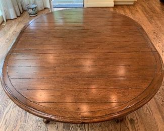 "Table with two extensions in great condition.  Dimensions 52"" round - 18"" extensions.  Price $950"