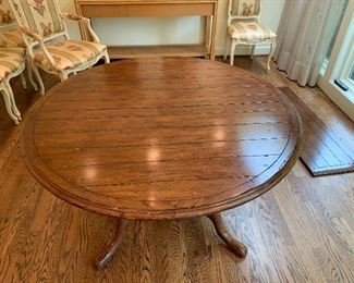 "After removing the extensions it becomes 52"" round table. $950"