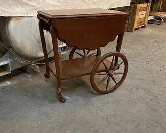Antique (light wood) cherry tea cart. $75