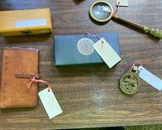 Wooden box, magnifying glass, wallet