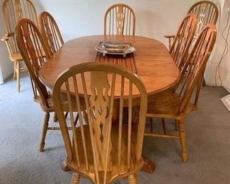 Table & 8 chairs  2 extensions 900.00