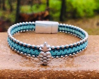 Pineapple turquoise leather bracelet with silver beads and magnetic clasp 32.00.  Call or email for sizing.  DesignsbyJeffJewelry@gmail.com