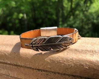 Feather silver on leather with magnetic clasp 32.  We can adjust size or change leather color.  Call or email for more info.  DesignsbyJeffJewelry@gmail.com 815.519.7653