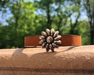 Sunflower on Leather Bracelet with strong magnetic clasp 32.  Call or email for more info.  DesignsbyjeffJewelry@gmail.com 815.519.7653