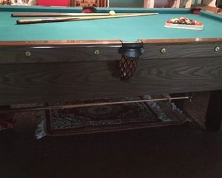 """A. E. Schmidt pool table and accessories (balls, cue sticks, cover, repair kit). 56""""x8'4""""."""