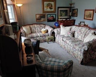 lovely floral couch and loveseat. the gray carpeting was new in December. it is for sale. cheap.