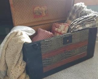 clean hip-top truck. lace tablecloths and homespun tablecloths. 2 large rag rugs.