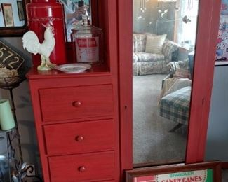 great drawers and cupboard unit. good color. large ceramic red jar, chicken, chicken plate and a planters peanut jar...old