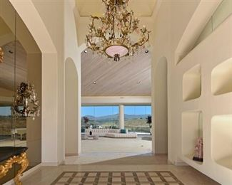 Magnificent Chandelier $4,000 and 2 sconces  $4,000- Rose Quartz , Rock Crystal - please note the sofa is sold