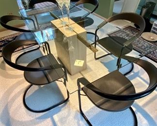 "Lot #1A.   Asking $525.  ($1200 online) Table Only.  Chairs sold in next lot.  Glass Beveled Edge and Travertine Stone Base Dining Room Table, c. 1970s,  With Brass Insert.  Good Condition - light usage scratches, but displays well.  Measures 78.5"" L x 39.25""W x 27.5"" H and thickness of glass abt 1/4"""