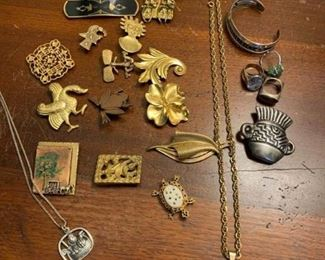 Pins Rings and Necklaces