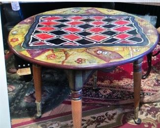 Paint Decorated Side Table with Stylized Game Top $130.00 (item located in storage, please contact if interested and we will arrange for the item to be on-site the day of the sale)