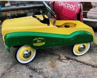 John Deere Gear Box Metal Peddle Car $450.00 (item located in storage, please contact if interested and we will arrange for the item to be on-site the day of the sale)