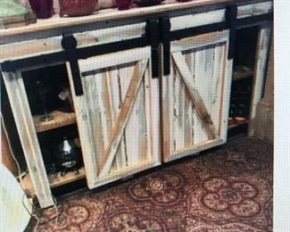 Hand Crafted. Paint Decorated Side Board with Metal Hardware and 'Barn Door' hung doors  $605.00