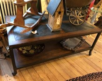 Industrial Coffee Table crafted from Wood, Steel and Stone.  Table is on wheels for ease of movement.  $500.00 (item located in storage, please contact if interested and we will arrange for the item to be on-site the day of the sale)