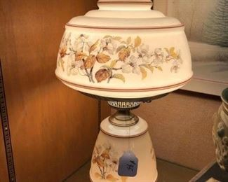 Pair of Hurricane Lamps, Tan Floral Pattern $150.00 (item located in storage, please contact if interested and we will arrange for the item to be on-site the day of the sale)