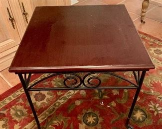 "As is $50 Wrought iron side table with wooden top.   Please note condition.  21"" x 21"" x 21""."